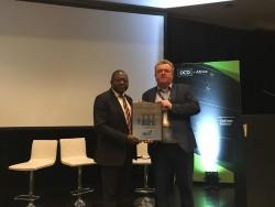 Adegbiji receives TCCF plaque.jpeg
